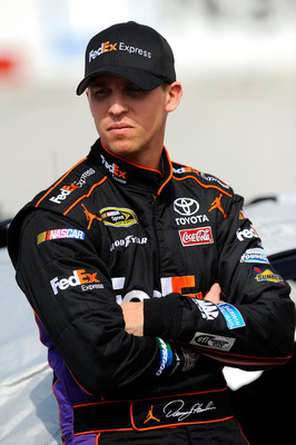 BRISTOL, TN - MARCH 18:  Denny Hamlin, driver of the #11 FedEx Express Toyota, stands on the grid prior to qualifying for the NASCAR Sprint Cup Series Jeff Byrd 500 Presented By Food City at Bristol Motor Speedway on March 18, 2011 in Bristol, Tennessee.