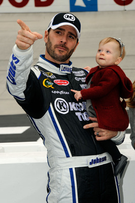 BRISTOL, TN - MARCH 20:  Jimmie Johnson (L), driver of the #48 Lowe's/Kobalt Tools Chevrolet, holds his daughter Genevieve Marie (C) on the grid prior to the start ofduring the NASCAR Sprint Cup Series Jeff Byrd 500 Presented By Food City at Bristol Motor