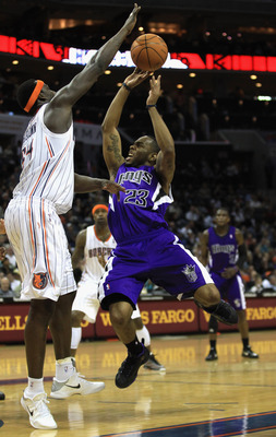 CHARLOTTE, NC - FEBRUARY 25:  Samuel Dalembert #10 of the Sacramento Kings shoots the ball over Kwame Brown #54 of the Charlotte Bobcats during their game at Time Warner Cable Arena on February 25, 2011 in Charlotte, North Carolina. NOTE TO USER: User exp