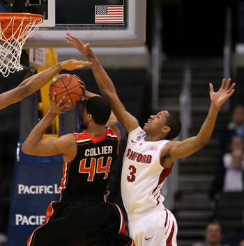 LOS ANGELES, CA - MARCH 09:  Devon Collier #44 of the Oregon State Beavers goes up for a shot between Anthony Brown #3 and Josh Owens #13 of the Stanford Cardinal in the second half of the first round of the 2011 Pacific Life Pac-10 Men's Basketball Tourn
