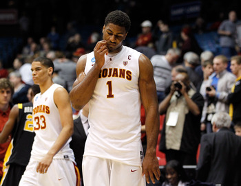 DAYTON, OH - MARCH 16: Alex Stepheson #1 and Garrett Jackson #33 of the USC Trojans walk off the court after being defeated by the Virginia Commonwealth Rams during the first round of the 2011 NCAA men's basketball tournament at UD Arena on March 16, 2011