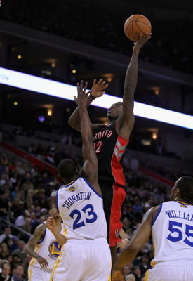 OAKLAND, CA - MARCH 25:  Ed Davis #32 of the Toronto Raptors shoots over Al Thornton #23 of the Golden State Warriors at Oracle Arena on March 25, 2011 in Oakland, California. NOTE TO USER: User expressly acknowledges and agrees that, by downloading and o
