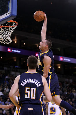 OAKLAND, CA - JANUARY 19:  Josh McRoberts #32 of the Indiana Pacers goes up for a dunk against the Golden State Warriors at Oracle Arena on January 19, 2011 in Oakland, California.  NOTE TO USER: User expressly acknowledges and agrees that, by downloading