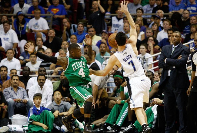 ORLANDO, FL - MAY 26:  J.J. Redick #7 of the Orlando Magic loses the ball as he drives against Nate Robinson #4 of the Boston Celtics in Game Five of the Eastern Conference Finals during the 2010 NBA Playoffs at Amway Arena on May 26, 2010 in Orlando, Flo
