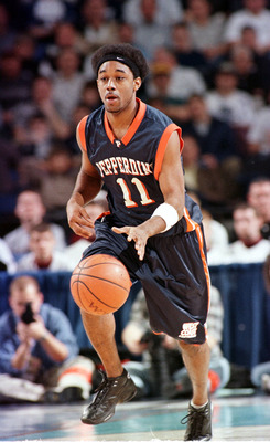 19 Mar 2000: Craig Lewis #11 of the Pepperdine Waves brings the ball up court during the NCAA East Regional second round game against the Oklahoma State Cowboys at the HSBC Arena in Buffalo, New York. Oklahoma State defeated Pepperdine 75-67 to advance to