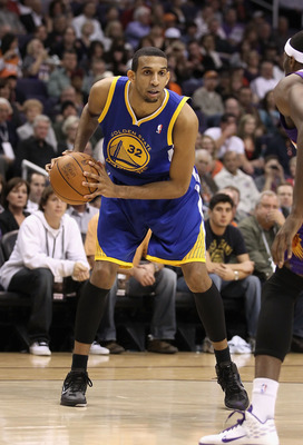 PHOENIX, AZ - FEBRUARY 10:  Brandan Wright #32 of the Golden State Warriors handles the ball during the NBA game against the Phoenix Suns at US Airways Center on February 10, 2011 in Phoenix, Arizona.  The Suns defeated the Warriors 112-88.  NOTE TO USER:
