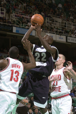 15 Mar 2001:  Curtis Bobb #22 of Utah State takes a shot while guarded by Brian Brown #13 and Boban Savovic #21 of Ohio State in the first round of the Men's NCAA Tournament at Greensboro Coliseum in Greensboro, North Carolina.  DIGITAL IMAGE Mandatory Cr