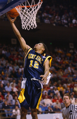LEXINGTON, KY - MARCH 21:  Andrew Mitchell #12 of the Kent State Golden Flashes lays a shot up during the Midwest Regional Semifinal during the 2002 NCAA Men's Basketball Tournament against the Pittsburgh Panthers on March 21, 2002 at Rupp Arena in Lexing