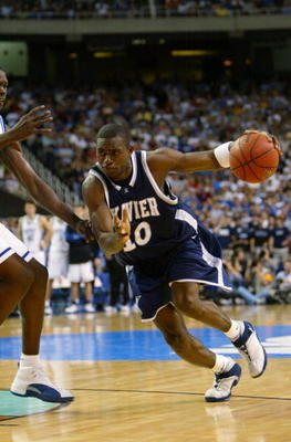 ATLANTA - MARCH 28:  Romain Sato #10 of the Xavier Musketeers drives against the Duke Blue Devils during the fourth round game of the NCAA Division I Men's Basketball Tournament at the Georgia Dome on March 28, 2004 in Atlanta, Georgia.  The Blue Devils w