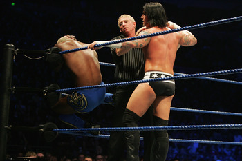 SYDNEY, AUSTRALIA - JUNE 15:  The referee seperates CM Punk (L) from Shelton Benjamin (R) during WWE Smackdown at Acer Arena on June 15, 2008 in Sydney, Australia.  (Photo by Gaye Gerard/Getty Images)