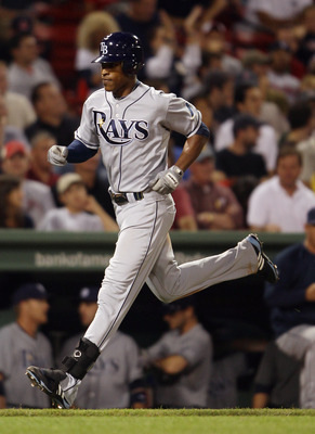 BOSTON - SEPTEMBER 07:  B.J. Upton #2 of the Tampa Bay Rays heads for home after he hit a solo home run in the sixth inning against the Boston Red Sox on September 7, 2010 at Fenway Park in Boston, Massachusetts.  (Photo by Elsa/Getty Images)