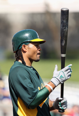 PHOENIX, AZ - MARCH 03:  Coco Crisp #4 of the Oakland Athletics prepares to bat during the spring training game against the Milwaukee Brewers at Maryvale Baseball Park on March 3, 2011 in Phoenix, Arizona.  (Photo by Christian Petersen/Getty Images)