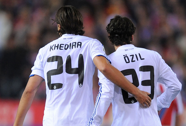 MADRID, SPAIN - MARCH 19:  Sami Khedira of Real Madrid celebrates with Mesut Ozil after Ozil scored Real's second goal during the La Liga match between Atletico Madrid and Real Madrid at Vicente Calderon Stadium on March 19, 2011 in Madrid, Spain.  (Photo