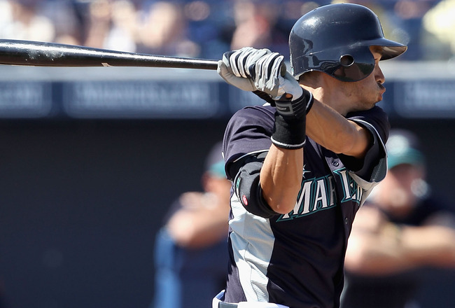 PEORIA, AZ - MARCH 12:  Ichiro Suzuki #51 of the Seattle Mariners hits a single against the Oakland Athletics during the second inning of the spring training game at Peoria Stadium on March 12, 2011 in Peoria, Arizona.  (Photo by Christian Petersen/Getty 