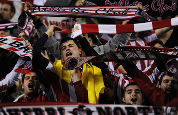 BILBAO, SPAIN - JANUARY 05:  Athletic Bilbao supporters cheer for their team during the round of last 16 Copa del Rey second leg match between Athletic Bilbao and FC Barcelona at Estadio de San Mames on January 5, 2011 in Bilbao, Spain. The match ended in