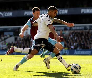 LONDON, ENGLAND - MARCH 19:  Aaron Lennon (R) of Tottenham in action against Wayne Bridge of West Ham during the Barclays Premier League match between Tottenham Hotspur and West Ham United at White Hart Lane on March 19, 2011 in London, England.  (Photo b