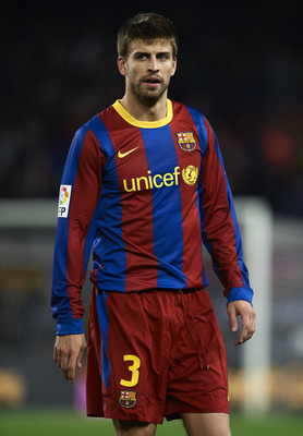 BARCELONA, SPAIN - MARCH 19:  Gerard Pique of Barcelona looks on during the La Liga match between Barcelona and Getafe at Camp Nou on March 19, 2011 in Barcelona, Spain. Barcelona won 2-1.  (Photo by Manuel Queimadelos Alonso/Getty Images)