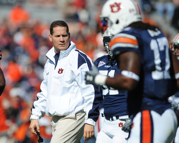 AUBURN, AL - NOVEMBER 06:  Coach Gene Chizik of the Auburn Tigers watches warmups before play against the Chattanooga Mocs November 6, 2010 at Jordan-Hare Stadium in Auburn, Alabama.  (Photo by Al Messerschmidt/Getty Images)