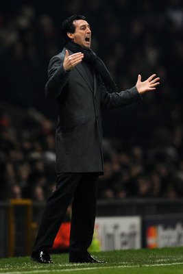 MANCHESTER, ENGLAND - DECEMBER 07:   Valencia Head Coach Unai Emery issues instructions during the UEFA Champions League Group C match between Manchester United and Valencia at Old Trafford on December 7, 2010 in Manchester, England.  (Photo by Clive Maso