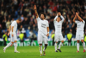 MADRID, SPAIN - MARCH 16: Marcelo (C) of Real Madrid salutes fans at the end of the UEFA Champions League round of 16 second leg match between Real Madrid and Lyon at Estadio Santiago Bernabeu on March 16, 2011 in Madrid, Spain.  (Photo by Denis Doyle/Get