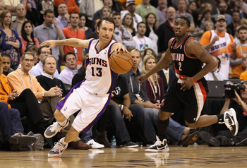 PHOENIX, AZ - JANUARY 14:  Steve Nash #13 of the Phoenix Suns handles the ball past Wesley Matthews #2 of the Portland Trail Blazers during the NBA game at US Airways Center on January 14, 2011 in Phoenix, Arizona.  The Suns defeated the Trail Blazers 115