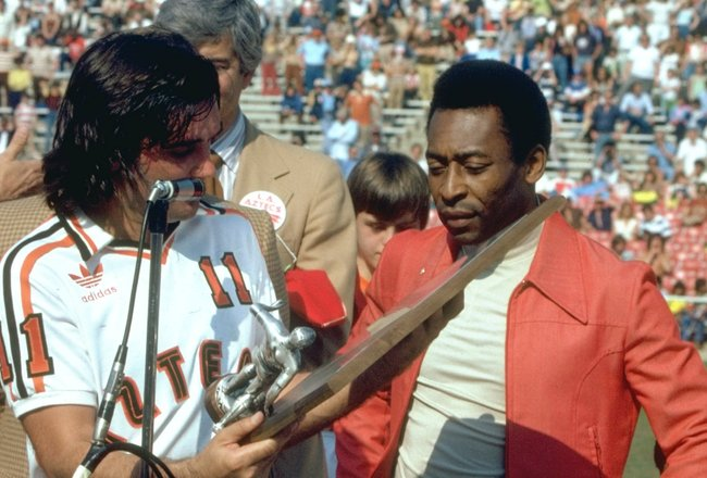 Apr 1987:  Pele (right) of Brazil is presented with the Greatest Soccer Player Trophy by George Best of Aztecs before an American League match between Aztecs and NY Cosmos at the Rose Bowl in Los Angeles, California, USA. \ Mandatory Credit: Tony  Duffy/A