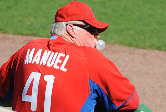 CLEARWATER, FL - FEBRUARY 24:  Manager Charlie Manuel #41 of the Philadelphia Phillies blows a bubble and watches play against the Florida State Seminoles February 24, 2011 at Bright House Field in Clearwater, Florida.  (Photo by Al Messerschmidt/Getty Im