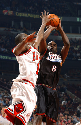 CHICAGO - MARCH 9:  Guard Aaron McKie #8 of the Philadelphia 76ers shoots over guard Jamal Crawford #1 of the Chicago Bulls during a game on March 9, 2004 at the United Center in Chicago, Illinois. The 76ers defeated the Bulls 89-81. NOTE TO USER: User ex