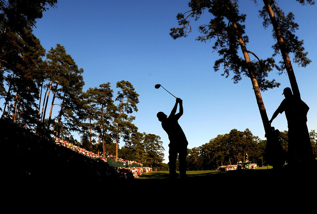 AUGUSTA, GA - APRIL 11:  Phil Mickelson plays his tee shot on the 14th hole as Lee Westwood of England looks on during the final round of the 2010 Masters Tournament at Augusta National Golf Club on April 11, 2010 in Augusta, Georgia.  (Photo by Harry How