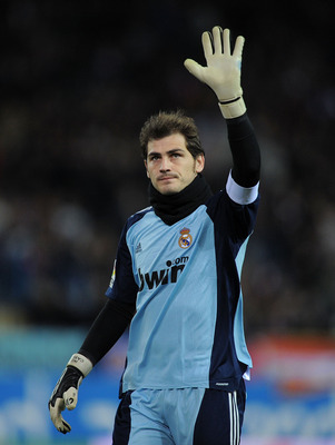 MADRID, SPAIN - JANUARY 20:  Iker Casillas of Real Madrid waves to Real fans during the Copa del Rey quarter final second leg match between Atletico Madrid and Real Madrid at Vicente Calderon Stadium on January 20, 2011 in Madrid, Spain.  (Photo by Denis
