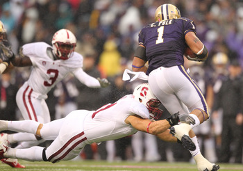 SEATTLE - OCTOBER 30:  Running back Chris Polk #1 of the Washington Huskies rushes against Shayne Skov #11 of the Stanford Cardinal on October 30, 2010 at Husky Stadium in Seattle, Washington. Stanford won 41-0. (Photo by Otto Greule Jr/Getty Images)