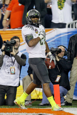 GLENDALE, AZ - JANUARY 10:  LaMichael James #21 of the Oregon Ducks celebrates during their Tostitos BCS National Championship Game against the Auburn Tigers at University of Phoenix Stadium on January 10, 2011 in Glendale, Arizona.  (Photo by Kevin C. Co