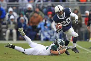 STATE COLLEGE, PA - NOVEMBER 27: Wide receiver Devon Smith #20 of the Penn State Nittany Lions runs with the ball during a game against the Michigan State Spartans on November 27, 2010 at Beaver Stadium in State College, Pennsylvania. The Spartans won 28-