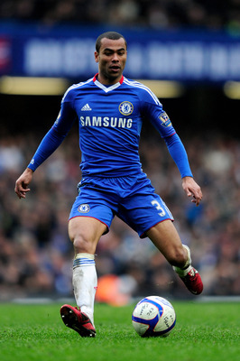 LONDON, ENGLAND - FEBRUARY 19:  Ashley Cole of Chelsea runs with the ball during the FA Cup sponsored by E.ON 4th round replay match between Chelsea and Everton at Stamford Bridge on February 19, 2011 in London, England.  (Photo by Jamie McDonald/Getty Im