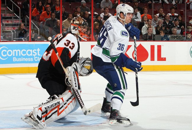 PHILADELPHIA - DECEMBER 03:  Jannik Hansen #36 of the Vancouver Canucks skates against Brian Boucher #33 of the Philadelphia Flyers on December 3, 2009 at Wachovia Center in Philadelphia, Pennsylvania. The Canucks defeated the Flyers 3-0.  (Photo by Jim M