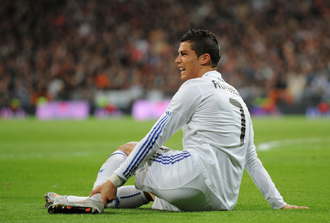 MADRID, SPAIN - NOVEMBER 07: Cristiano Ronaldo  of Real Madrid reacts after being fouled during the La Liga match between Real Madrid and Atletico Madrid at Estadio Santiago Bernabeu on November 7, 2010 in Madrid, Spain.  (Photo by Denis Doyle/Getty Image