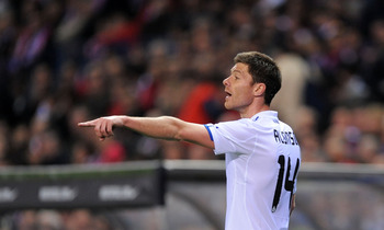 MADRID, SPAIN - MARCH 19: Xabi Alonso #14 of Real Madrid instructs a teammate during the La Liga match between Atletico Madrid and Real Madrid at Vicente Calderon Stadium on March 19, 2011 in Madrid, Spain.  (Photo by Denis Doyle/Getty Images)