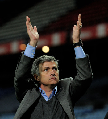 MADRID, SPAIN - MARCH 19:  Head coach Jose Mourinho of Real Madrid applauds travelling Rreal fans at the end of the La Liga match between Atletico Madrid and Real Madrid at Vicente Calderon Stadium on March 19, 2011 in Madrid, Spain.  (Photo by Denis Doyl