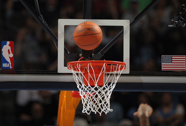 DENVER - NOVEMBER 16:  A detail photo of the ball as it falls through the rim as the Denver Nuggets face the New York Knicks at the Pepsi Center on November 16, 2010 in Denver, Colorado. The Nuggets defeated the Knicks 120-118. NOTE TO USER: User expressl