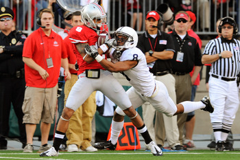 COLUMBUS, OH - NOVEMBER 13:  DeVier Posey #8 of the Ohio State Buckeyes pulls in a 49-yard pass reception as D'Anton Lynn #8 of the Penn State Nittany Lions defends at Ohio Stadium on November 13, 2010 in Columbus, Ohio.  (Photo by Jamie Sabau/Getty Image