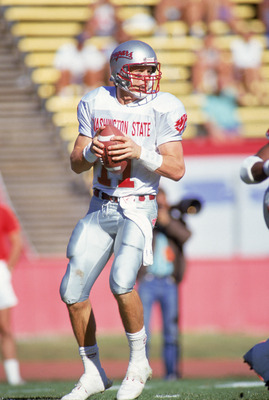 PULLMAN, WA - NOVEMBER 3:  Quarterback Drew Bledsoe #11 of the Washington State Cougars looks to pass during a game against the Stanford Cardinals on November 3, 1990 in Pullman, Washington. Stanford won 31-13. (Photo by: Otto Greule Jr/Getty Images)