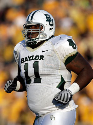 COLUMBIA, MO - NOVEMBER 07:  Defensive tackle Phil Taylor #11 of the Baylor Bears in action during the game against the Missouri Tigers at Faurot Field at Memorial Stadium on November 7, 2009 in Columbia, Missouri.  (Photo by Jamie Squire/Getty Images)