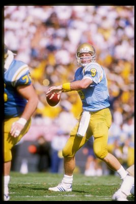 29 Oct 1988:  Quarterback Troy Aikman of the UCLA Bruins looks to pass the ball during a game against the Washington State Cougars at the Rose Bowl in Pasadena, California.  Washington State won the game 34-30. Mandatory Credit: Mike Powell  /Allsport