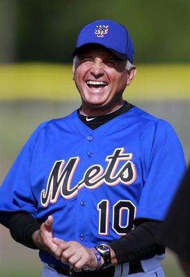 PORT ST. LUCIE, FL - FEBRUARY 17:  Manager Terry Collins #10 of the New York Mets laughs during spring training at Tradition Field on February 17, 2011 in Port St. Lucie, Florida.  (Photo by Marc Serota/Getty Images)