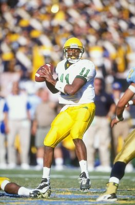 17 Oct 1998: Quarterback Akili Smith #11 of the Oregon Ducks in action during the game against the UCLA Bruins at the Rose Bowl in Pasadena, California. The Bruins defeated the Ducks 41-38.