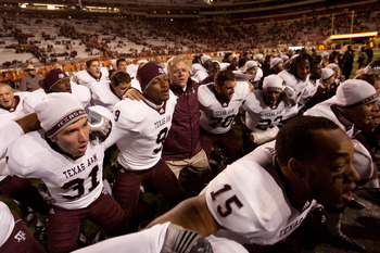 AUSTIN, TX - NOVEMBER 25:  Mike Sherman, head coach of Texas A&M, joins players in a post-game singing of the Aggie War Hymn following Texas A&M's 24-17 win over the University of Texas at Darrell K. Royal-Texas Memorial Stadium on November 25, 2010 in Au