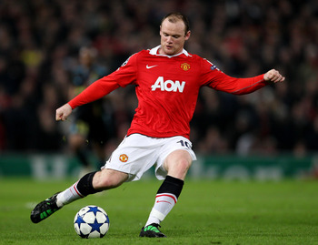 MANCHESTER, ENGLAND - MARCH 15:  Wayne Rooney of Manchester United in action during the UEFA Champions League round of 16 second leg match between Manchester United and Marseille at Old Trafford on March 15, 2011 in Manchester, England.  (Photo by Alex Li