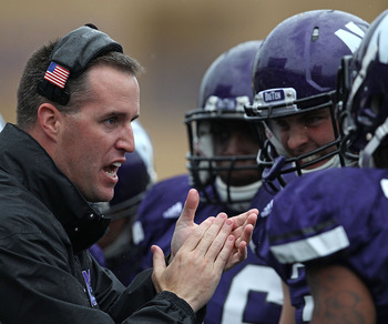 EVANSTON, IL - OCTOBER 23: Head coach Pat Fitzgerald of the Northwestern Wildcats encourages his players during a game against the Michigan State Spartans at Ryan Field on October 23, 2010 in Evanston, Illinois. Michigan State defeated Northwestern 35-27.