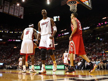 MIAMI, FL - MARCH 27:  Forward Chris Bosh #1 of the Miami Heat reacts against the Houston Rockets  at American Airlines Arena on March 27, 2011 in Miami, Florida. NOTE TO USER: User expressly acknowledges and agrees that, by downloading and/or using this