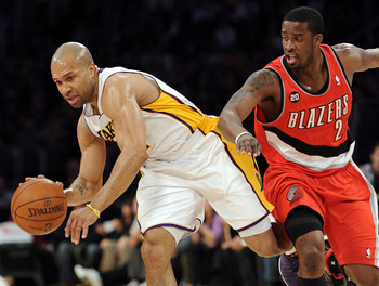 LOS ANGELES, CA - MARCH 20:  Derek Fisher #2 of the Los Angeles Lakers keeps his dribble from Wesley Matthews #2 of the Portland Trail Blazers at the Staples Center on March 20, 2011 in Los Angeles, California.  NOTE TO USER: User expressly acknowledges a